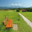 Stock Photo: Rural walkway and bench, pictorial bavarilandscape