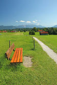 Rural walkway and bench, pictorial bavarian landscape — Stock Photo