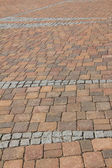 Pavement background of red and gray cobble stones — Stock Photo