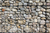 Modern natural filled stone wall — Stock Photo