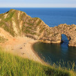 Durdle door and sandy beach, dorset landmark — Stock Photo #49657945