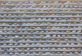 Wall with embedded pebble stones  — Stock Photo