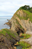 Rocky coast lulworth with sediment — Stock Photo