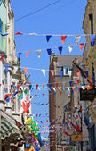 Festive bunting flags in the street — Stock Photo