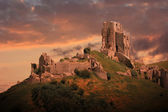 Corfe castle with romantic sunset sky — Stock Photo