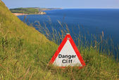 Danger cliff - caution sign — Stockfoto