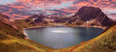 Mountain range and artificial lake lunersee, austria — Stock Photo