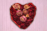 Love heart with dried rose buds — Stock Photo