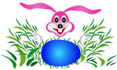 Easter bunny rabbit looking for eggs in the grass — Wektor stockowy