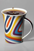 Coffee cup with colorful a drop on top — Stock Photo