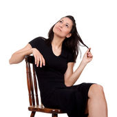 Woman on chair — Stock Photo