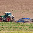 Tractor working on field — Stock Photo #26815163
