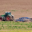 Tractor working on the field — Stock Photo