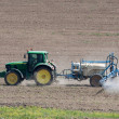 Tractor working on the field — Stock Photo #26815295