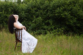 Woman on old chair — Stock Photo
