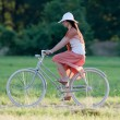 Retro girl on old bike — Stock Photo
