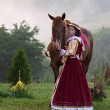 Woman in dress royal baroque riding — Stock Photo