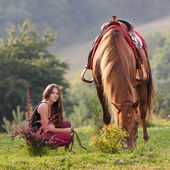 Young girl with a horse — Stock Photo
