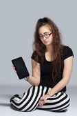 Teenage girl with tablet — Stock Photo