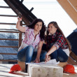 Two young women workers on the roof — Stock Photo #42723373