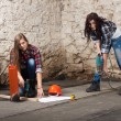 Two young long-haired woman with a drill and screwdriver — Stock Photo #42725295
