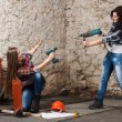 Two young long-haired woman with a drill and screwdriver — Stock Photo #42725717