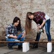 Two long-haired young woman with an angle grinder — Stock Photo #42726199