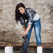 Young long-haired woman with an angle grinder — Stock Photo