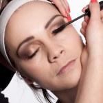 Painting of women eyelashes using mascara — Stock Photo #44534827