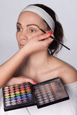 Painting female eyebrows — Stock Photo