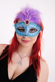 Young plump red-haired woman with mask — Stock Photo