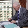 Senior Businessman Writing Notes — Stock Photo