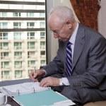 Senior Businessman Writing Notes — Stock Photo