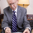Senior Businessman Going Over Papers — Stock Photo