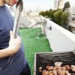 Munching Off the Grill - Stock Photo