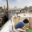 Stock Photo: Using Rooftop Lavatory