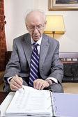 Senior Businessman Going Over Budget — Stock Photo