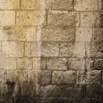 Постер, плакат: Sunlit Stone Wall Background