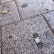 Stock Photo: Band-Aid on Pavement