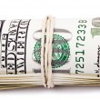 Roll of 100 US dollar  Bills - Stock Photo