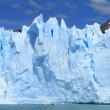A glacier cliff on the water of a lake — Stock Photo