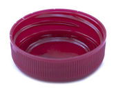 Rear view of a single pink-red plastic bottle cap — Stock Photo