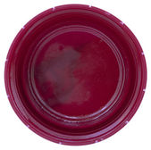 Bottom side of a pink plastic bottle cap — Stock Photo