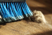Broom, Dirt and Fur Ball on Parquet Floor — Stock Photo