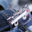 Audio Cassette on Denim - Stock Photo