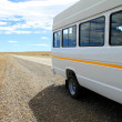 Minibus on Roadside - Stock Photo