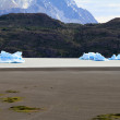 The remains of a glacier in the mode of small ice islands - Stock Photo