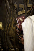 Praying infront of the Bible Cabinet — Stock Photo