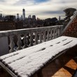 Snow Covered Picnic Table & New-York Skyline - Stock Photo