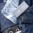 Audio Cassettes on Denim - Stock Photo